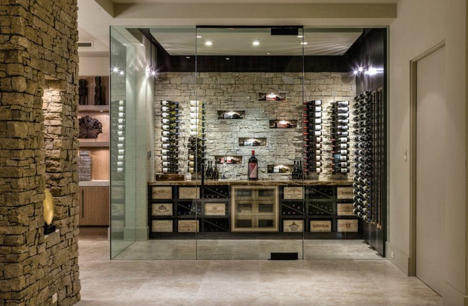 What is a Humidor for a Contemporary Wine Cellar with a Beige Color Wine Room and Custom Home Palm Desert Indoor Outdoor Living by Blackbird Interiors