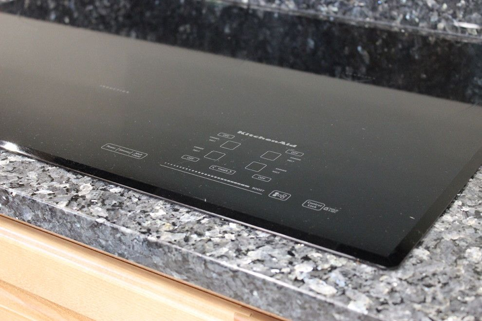 What is an Induction Cooktop for a Traditional Kitchen with a Induction and Colona, Il  Entire Home Restored After Fire & Smoke Damage by Village Home Stores