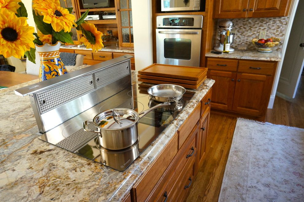 What is an Induction Cooktop for a Traditional Kitchen with a Serving and Custom Cherry Cooktop Cover by Home Restoration Services, Inc.