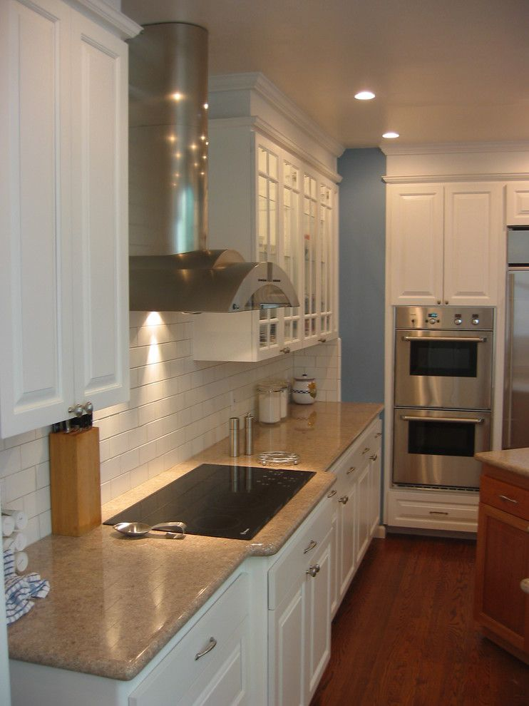What is an Induction Cooktop for a Traditional Kitchen with a Whit Kitchen and Vallejo by Design Solutions