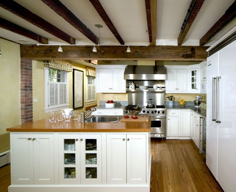 Whistling Kettle for a Traditional Kitchen with a Wood Cabinets and Crystal White Painted Inset by Kleppinger Design Group, Inc.