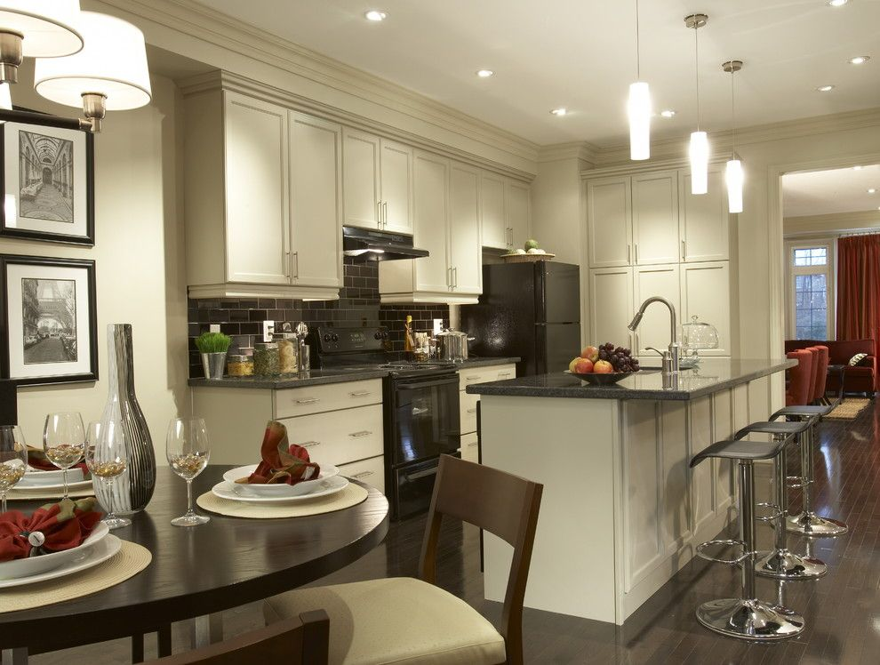 Who Makes Kenmore Appliances for a Traditional Kitchen with a Tile Backsplash and Open Concept Kitchen by David Nosella Interior Design