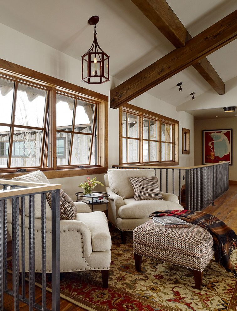Wholesale Builders Supply for a Farmhouse Hall with a Patterned Ottoman and Shooting Star Residence by Teton Heritage Builders