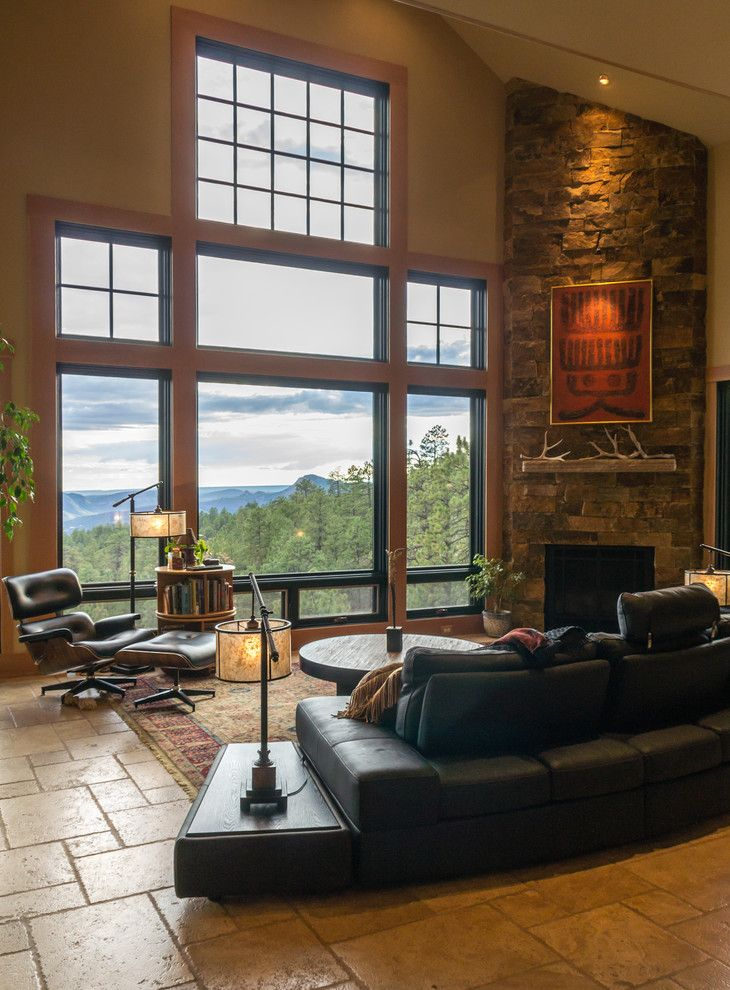 Wholesale Builders Supply for a Rustic Living Room with a Curved Sectional and Mountain Zen by Kogan Builders