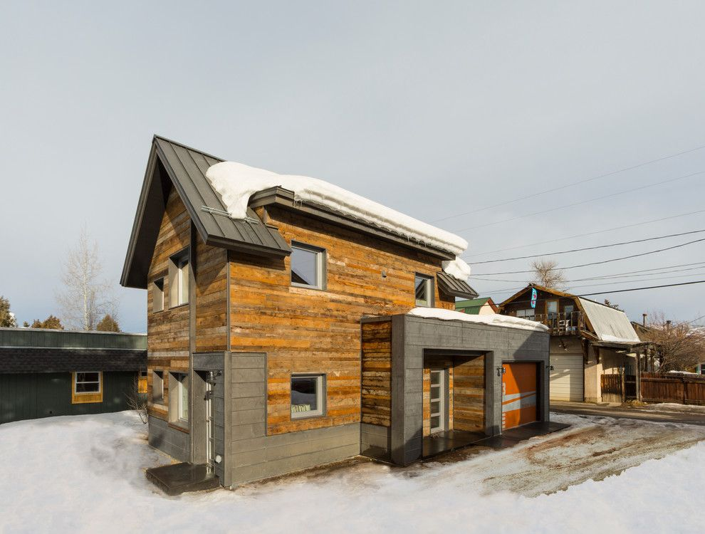 Wimsatt Building Materials for a Contemporary Exterior with a Metal Roof and Diagon Alley Passive House by Workshopl
