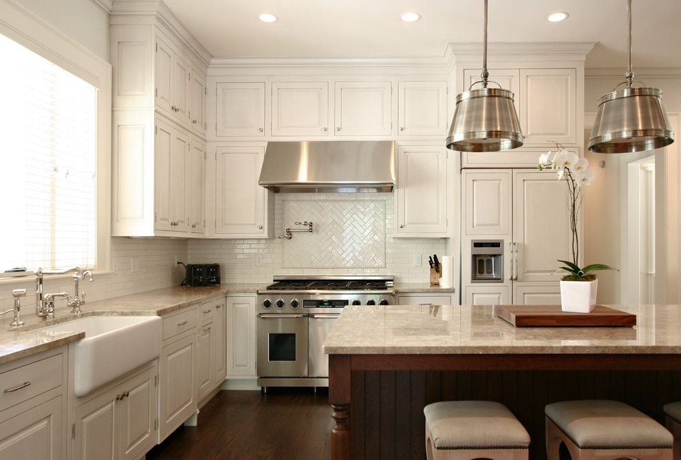 Wimsatt Building Materials for a Traditional Kitchen with a Panel Refrigerator and Kitchen by Dresser Homes