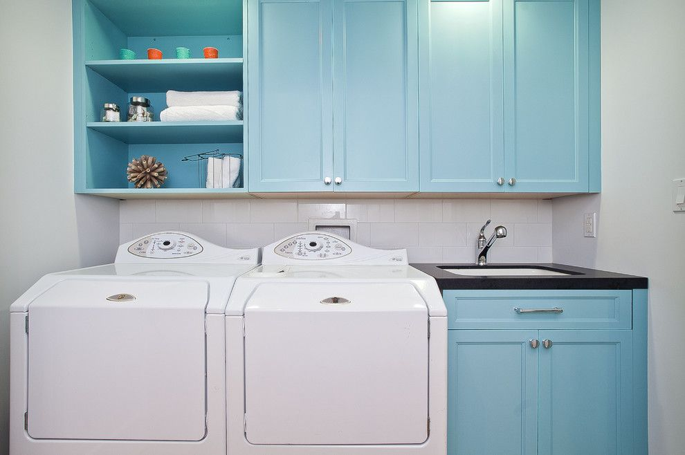 Winchester Ma Real Estate for a Beach Style Laundry Room with a Light Blue Cabinets and Beach Street Laundry by Melissa Lenox Design