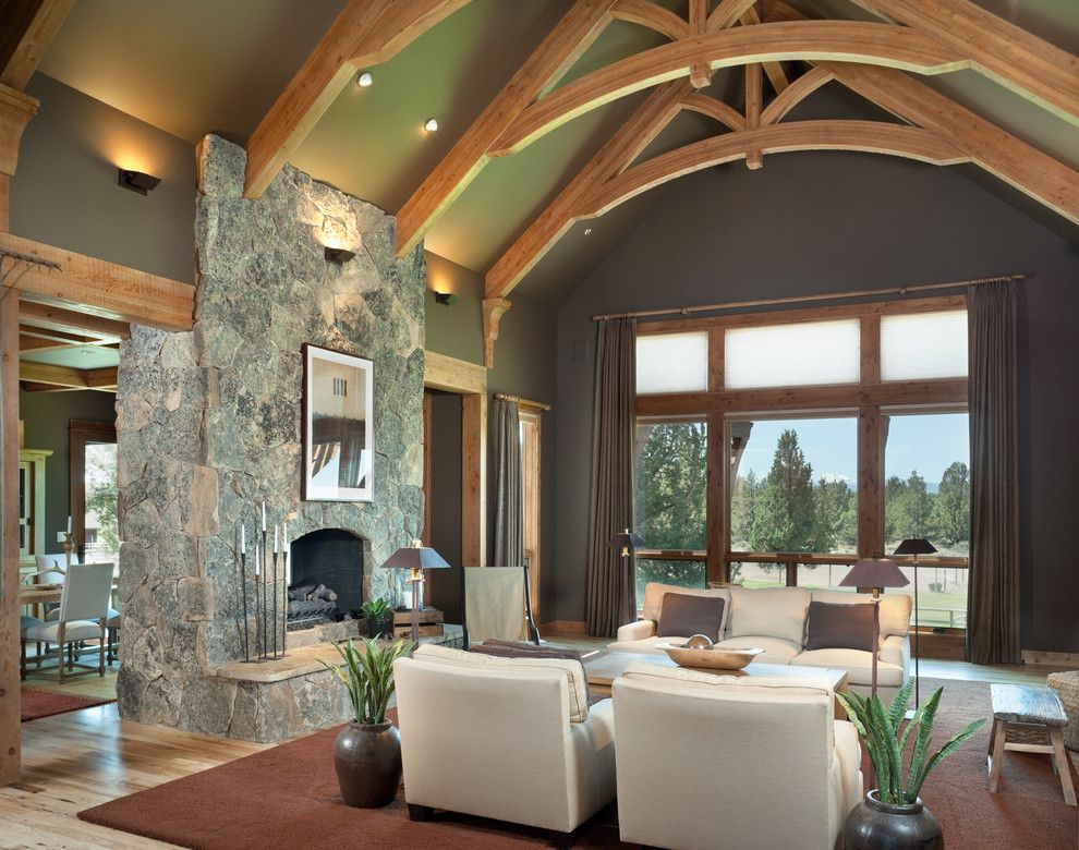 Window Depot Tucson for a Rustic Living Room with a Wall Sconce and True Residence by Alan Mascord Design Associates Inc