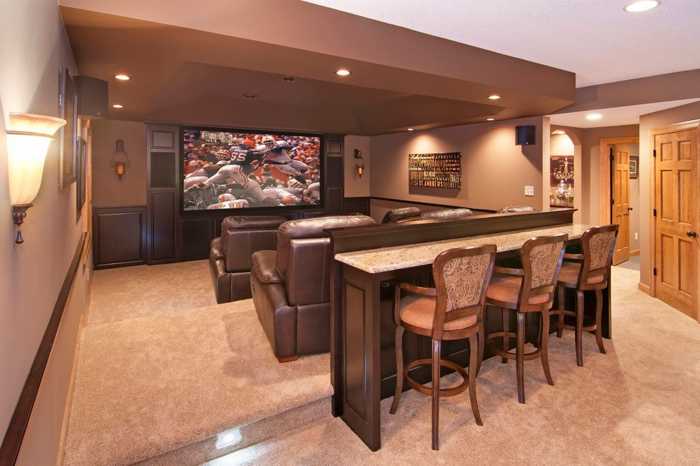 Winnetka Movie Theater for a Traditional Home Theater with a Raised Panel Doors and Pehle Lower Level by College City Design Build