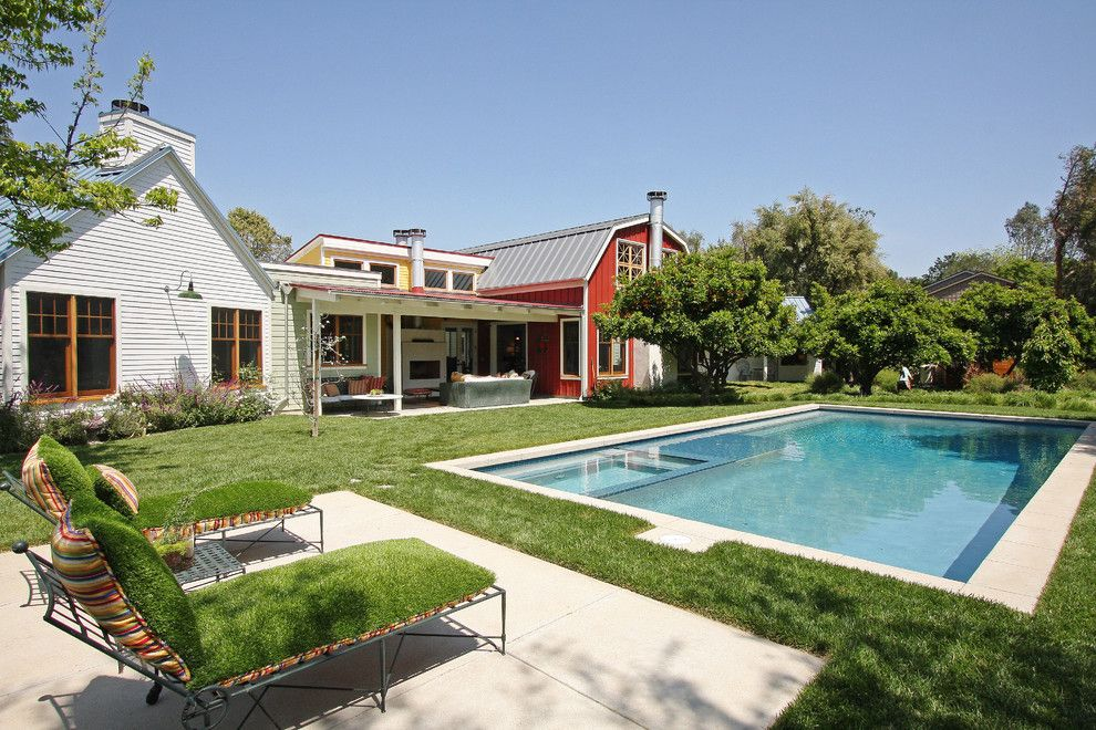 Woerner Turf for a Farmhouse Pool with a Red House and Contemporary Barn by Gus Duffy Aia