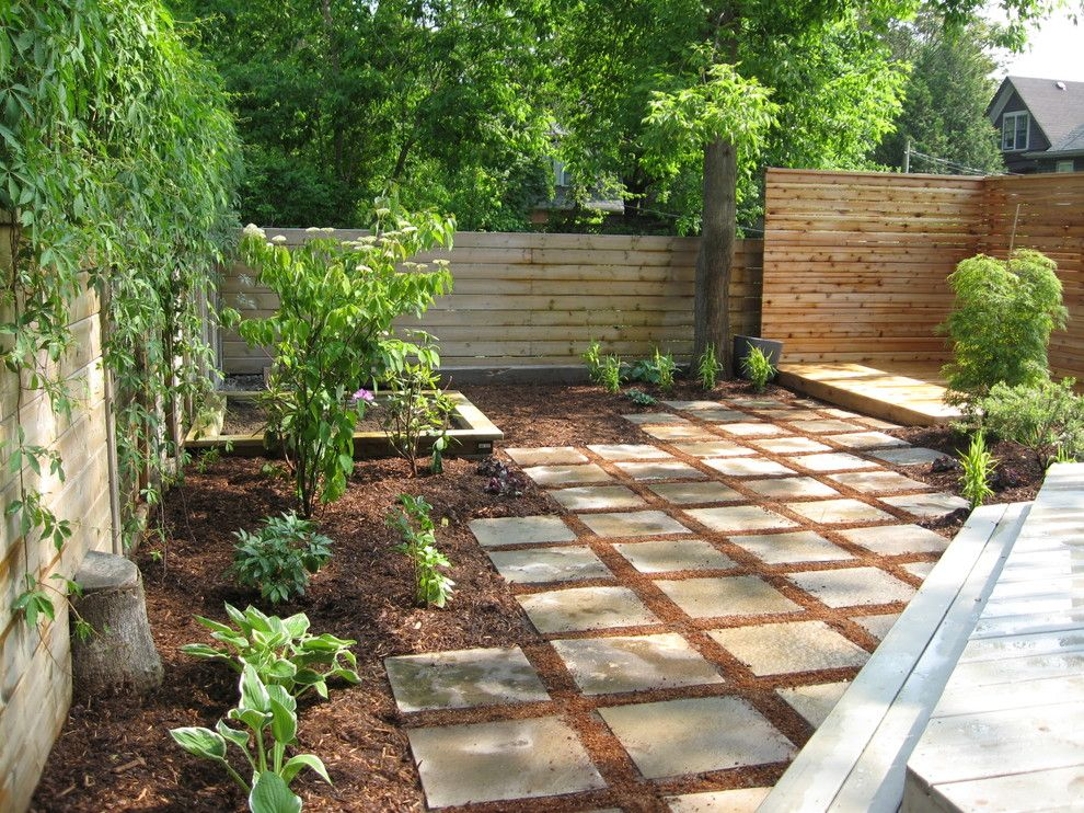 Woerner Turf for a Modern Landscape with a Japanese Maple and Outdoor Dining Terrace by Genus Loci Ecological Landscapes Inc.
