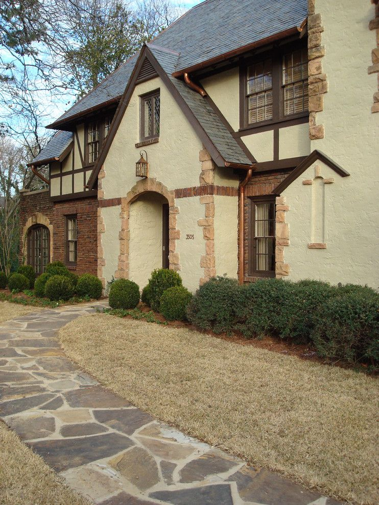 Woerner Turf for a Traditional Exterior with a Copper Downspouts and Tudor Entry by Studio C Architecture & Interiors