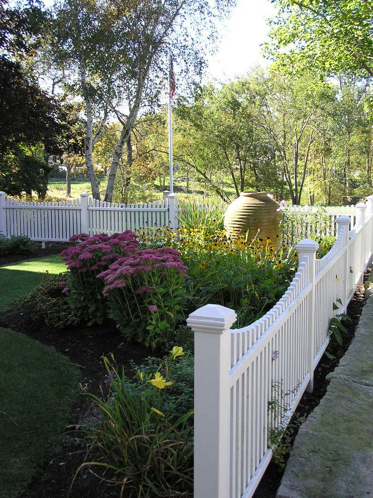 Woerner Turf for a Traditional Landscape with a Grass and Family Pool by Woodburn & Company Landscape Architecture, Llc