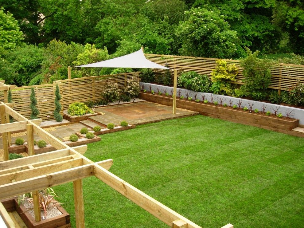Woerner Turf for a Traditional Landscape with a Shade Structure and Eggs Garden by Ben Kirbyshire
