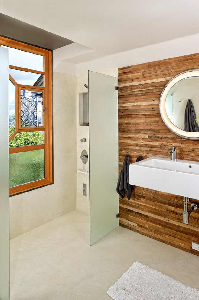 Wood Lathe Projects for a Contemporary Bathroom with a Circular Mirror and Prentiss Bathroom by Prentiss Balance Wickline Architects