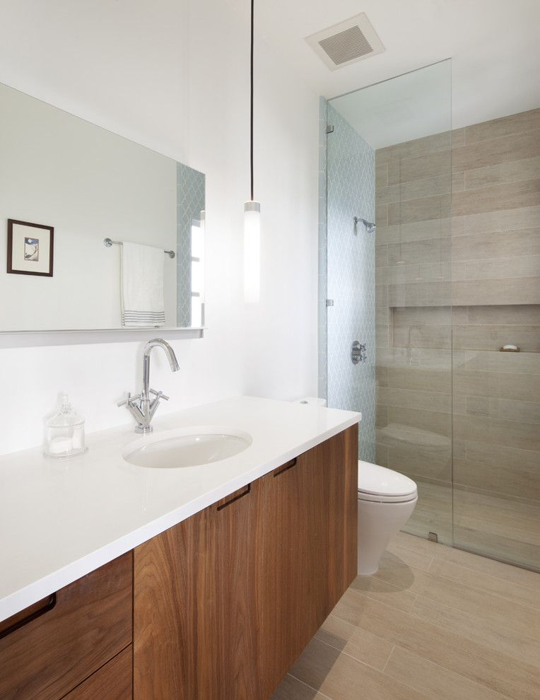 Wood Lathe Projects for a Contemporary Bathroom with a Floating Vanity and Master Bath by Jeff King & Company