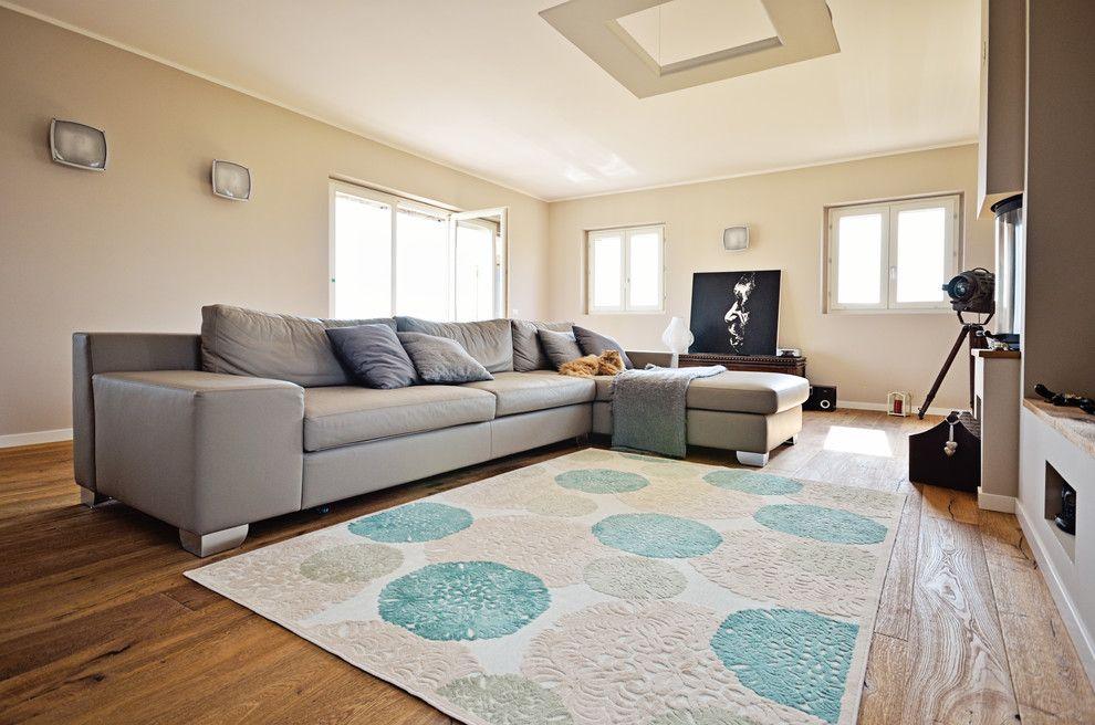 Woodco for a Modern Family Room with a Borgo and Ristrutturazione Antico Borgo Con Parquet by Woodco