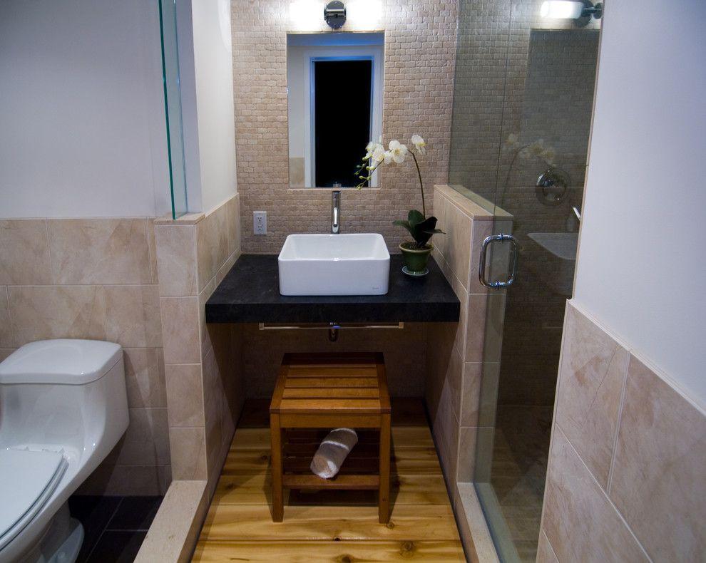 Woodgrain Doors for a Asian Bathroom with a Black Counter and Japanese Modern by Biglarkinyan Design Planning Inc.