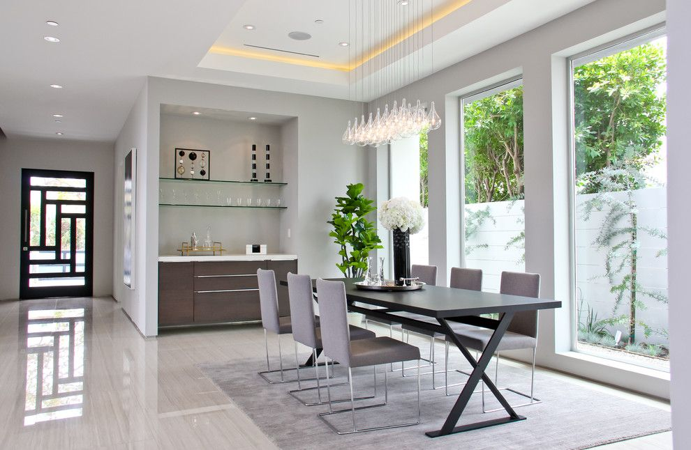 Woodgrain Doors for a Contemporary Dining Room with a Pendant Lighting and Alfred by Boswell Construction