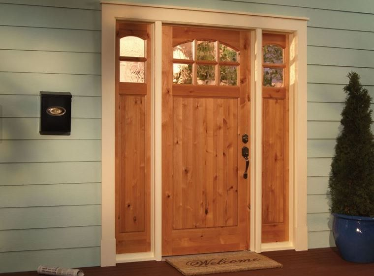 Woodgrain Doors for a Traditional Exterior with a Exterior Door and Curb Appeal with a New Front Door by Southern Supply
