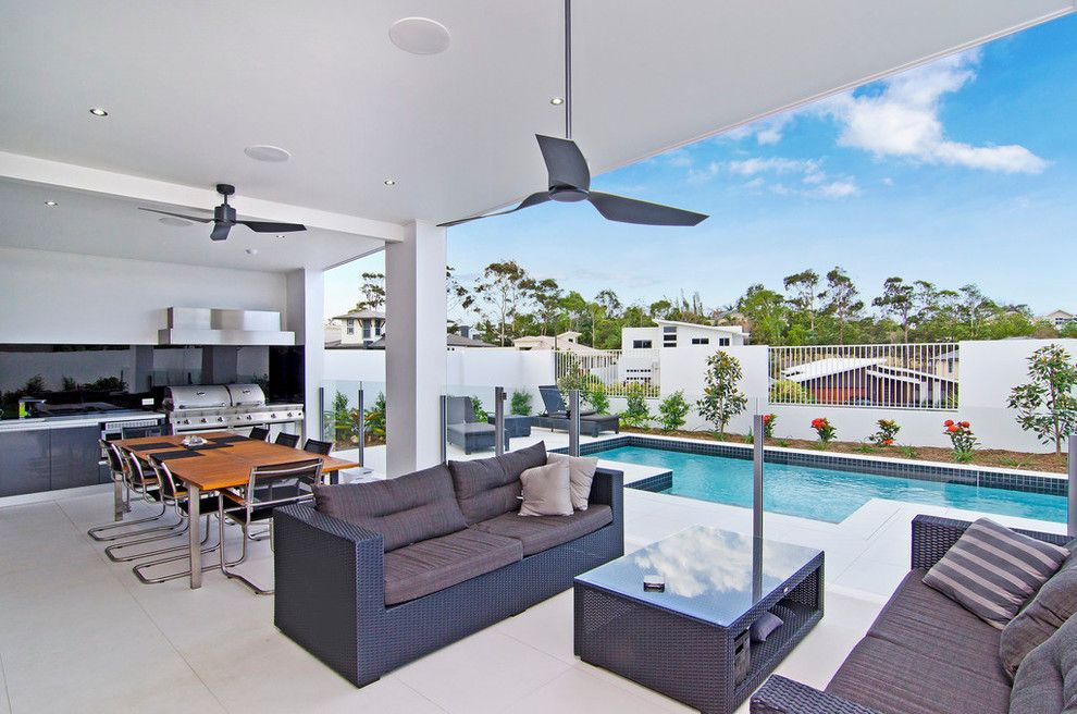 Zanos for a Contemporary Patio with a Metal Fence and Sanctuary Cove Stunner by Coastech Constructions