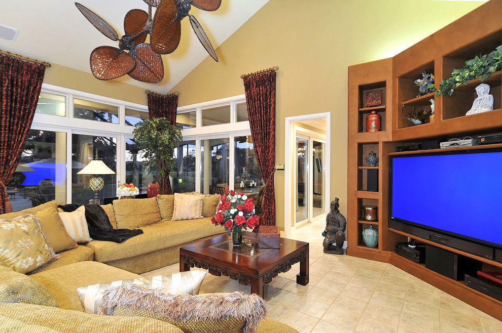 Zanos for a Tropical Home Theater with a Collection and Grand Media Room by Bella Luna Services, Inc.