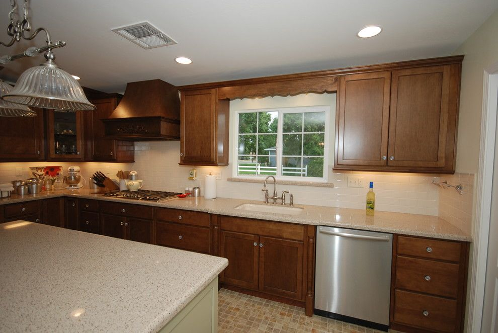 Zodiaq Countertops for a Traditional Kitchen with a Quartz and Cognac and Willow with Savory by Blue River Cabinetry