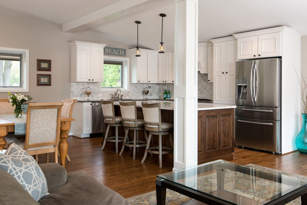 Zodiaq Countertops for a Transitional Kitchen with a Cambria Quartz Countertops and Commerce Township Lakeside Kitchen by Andrea Serrico