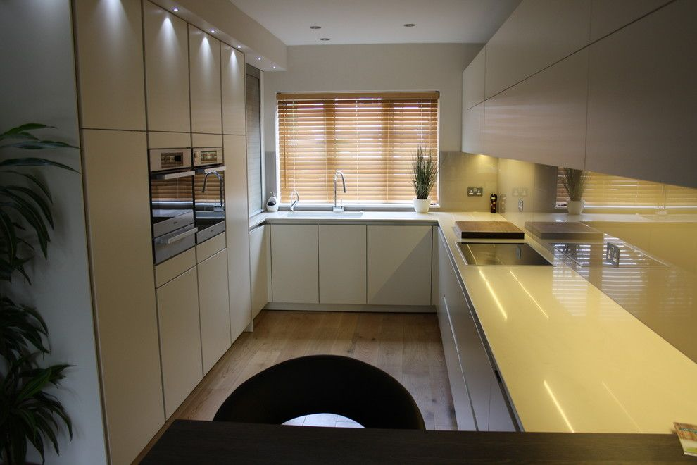 Zucchetti for a Contemporary Kitchen with a Glass Splashback and Tw1 by John Roberts Design Ltd